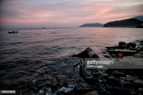 Deflated rubber boats and other debris along the shoreline left by asylumseekers and refugees arriving in Greece In 2015 more than a million...