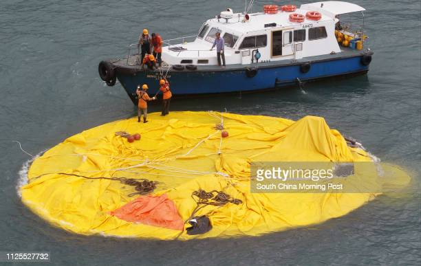 A deflated Rubber Duck created by Dutch artist Florentijn Hofman floats on the water at Victoria Harbor near Ocean Terminal 15MAY13