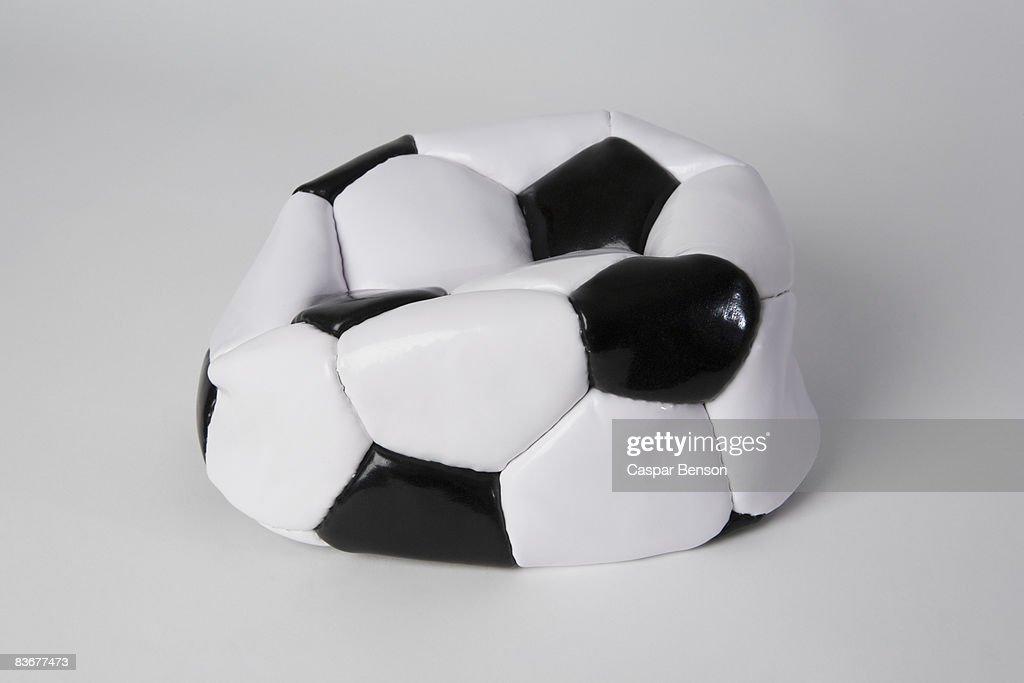 A deflated soccer ball : Stock Photo