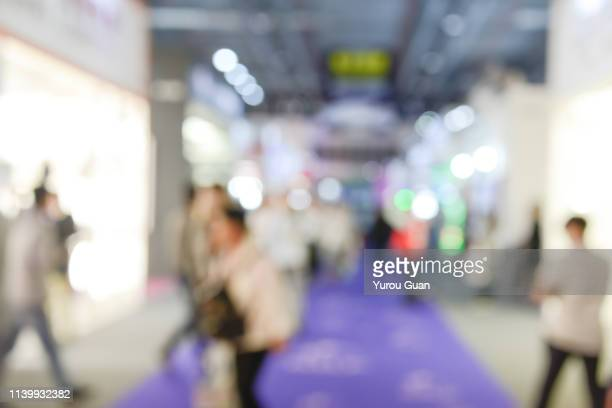 defocus background of public exhibition in trade show . abstract background used for business. - tradeshow stock pictures, royalty-free photos & images