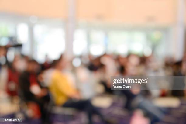 defocus backgrounds of forum or meeting scene in trade show, zhongshan,guangdong,china. - participant stock pictures, royalty-free photos & images