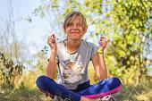 defocus caucasian preteen girl practicing yoga
