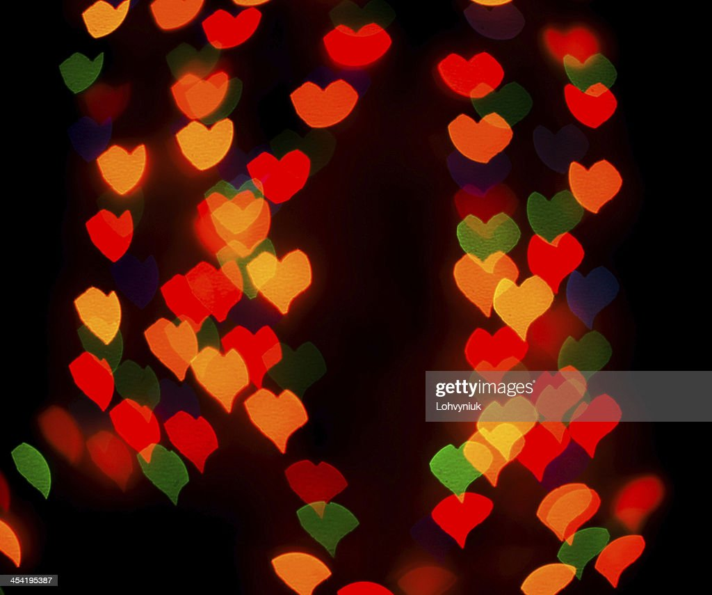 Defocused background lights or bokeh in the form of heart : Stock Photo