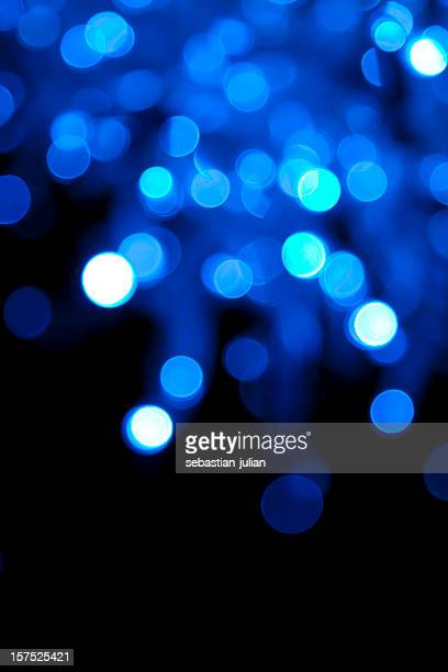 defocused blue light dots against black background