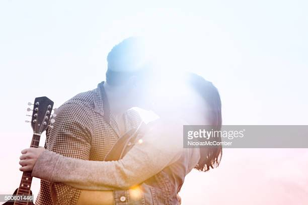 Defocused dreamlike kiss in full colored lens flare