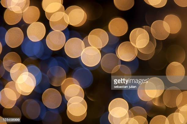 defocused golden light dots against black background