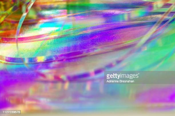 defocused holographic ribbons and foil - tinsel stock pictures, royalty-free photos & images
