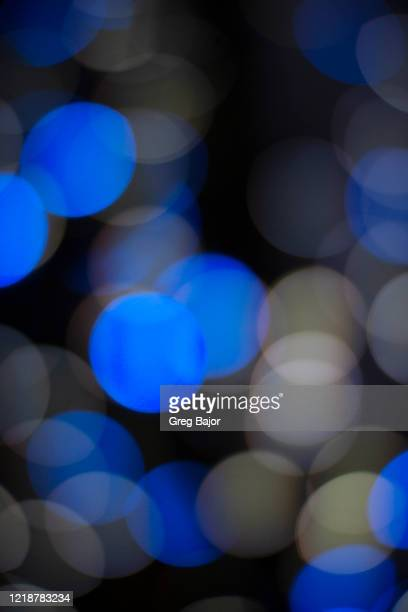 defocused illuminated lights - greg bajor stock pictures, royalty-free photos & images