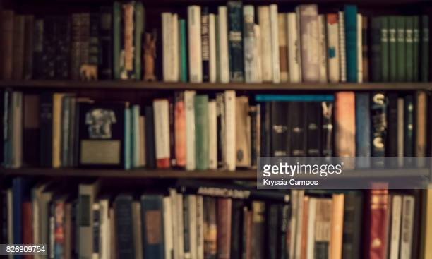 defocused image of bookshelf - book store stock photos and pictures