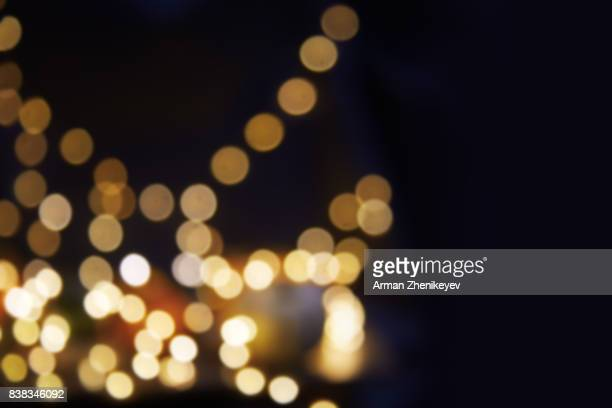 defocused image of christmas light bokeh - muted backgrounds stock pictures, royalty-free photos & images