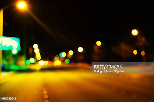 defocused image of city street at night - santa clarita stock pictures, royalty-free photos & images