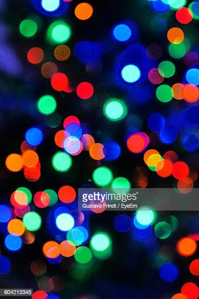 Defocused Image Of Colorful Illuminated Lights On Christmas Tree