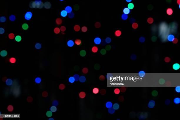 defocused image of colorful illuminated lights - ディスコ照明 ストックフォトと画像