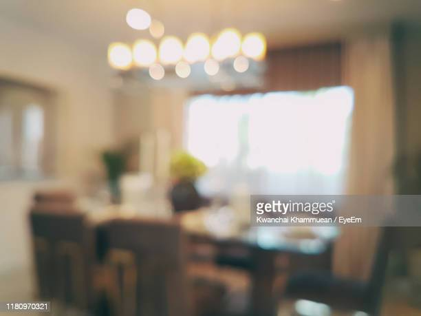 defocused image of empty chairs and table - focus on foreground stock pictures, royalty-free photos & images
