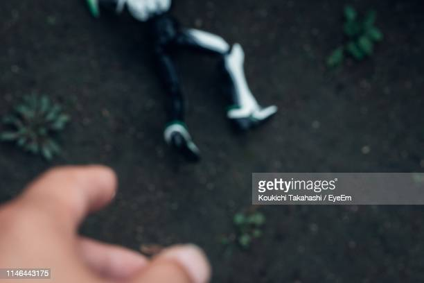 Defocused Image Of Hand Gesturing Outdoors