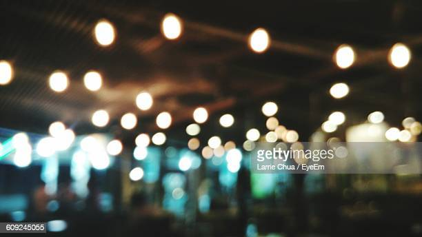 Defocused Image Of Illuminated Cafe Interior