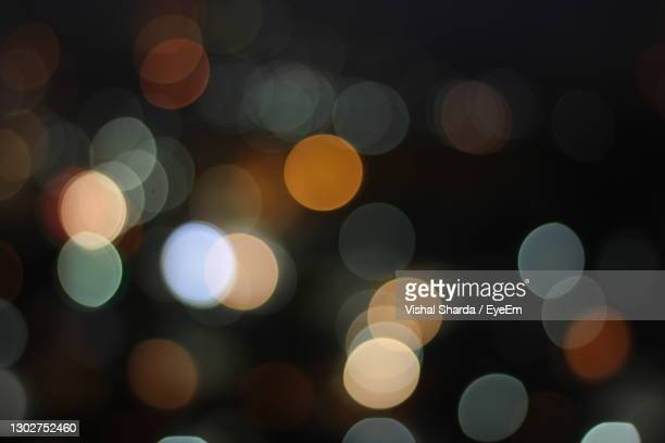 defocused image of illuminated christmas lights - chandigarh stock pictures, royalty-free photos & images