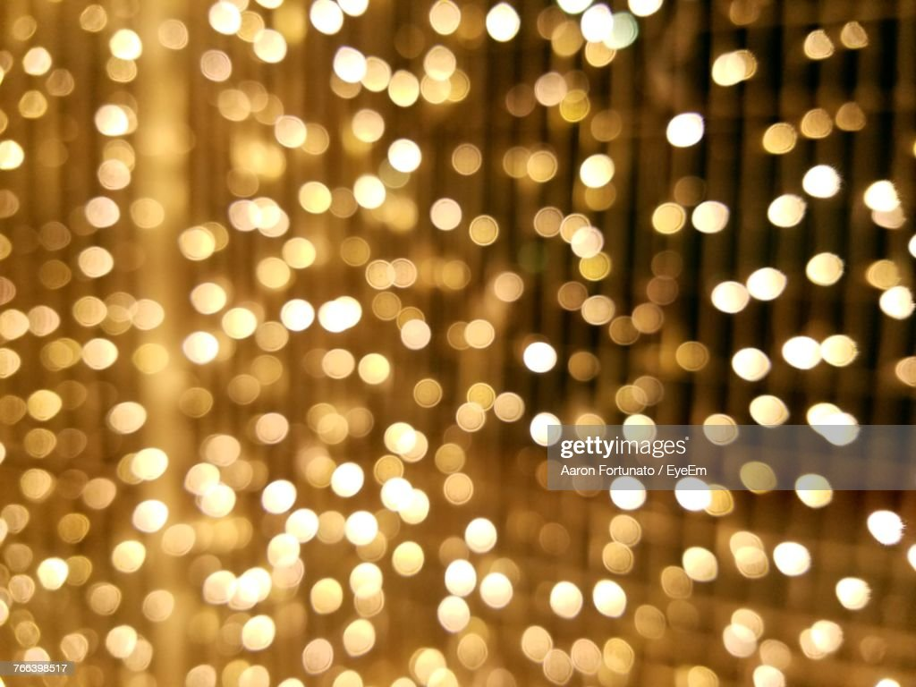 Defocused Image Of Illuminated Christmas Lights : Stock Photo