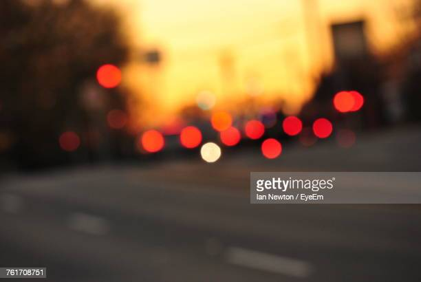 defocused image of illuminated city at night - focus on foreground stock pictures, royalty-free photos & images