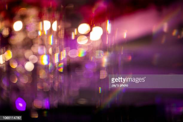 defocused image of illuminated city - glamour photos et images de collection