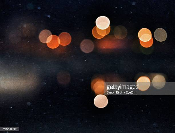 defocused image of illuminated city - licht stock-fotos und bilder