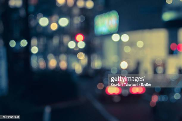 Defocused Image Of Illuminated City Street