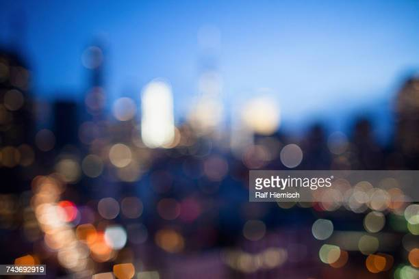 Defocused image of illuminated cityscape at dusk