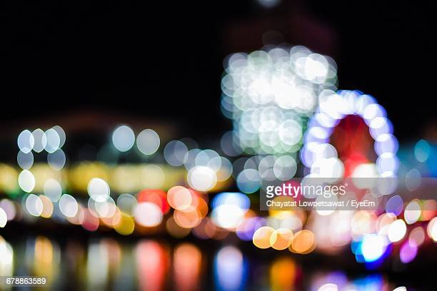 defocused image of illuminated darling harbor at night - darling harbour stock pictures, royalty-free photos & images