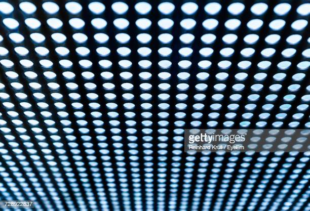 defocused image of illuminated light bulbs - metal music stock photos and pictures