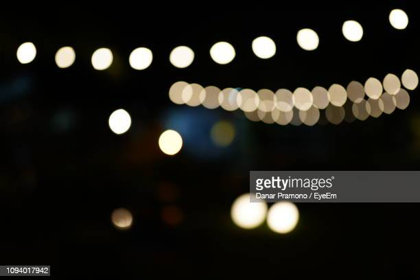 defocused image of illuminated lights at night - pendant light stock pictures, royalty-free photos & images