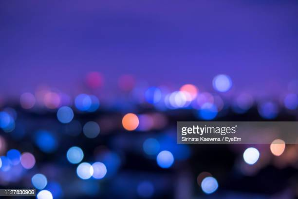 defocused image of illuminated lights at night - defocussed stock pictures, royalty-free photos & images