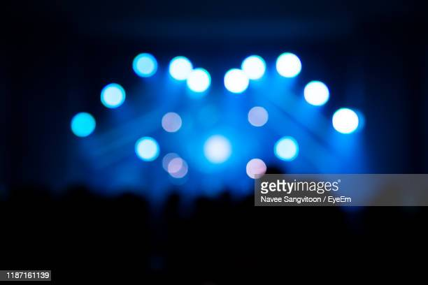 defocused image of illuminated lights at night - popular music concert stock pictures, royalty-free photos & images
