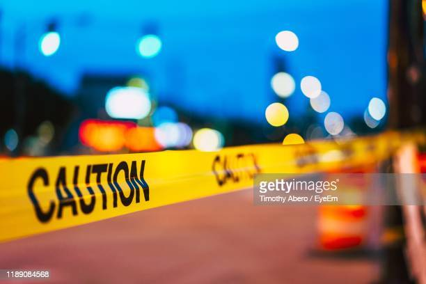 defocused image of illuminated lights at night - cordon tape stock pictures, royalty-free photos & images