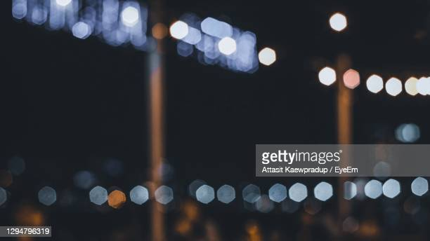 defocused image of illuminated lights at night - focus on foreground stock pictures, royalty-free photos & images