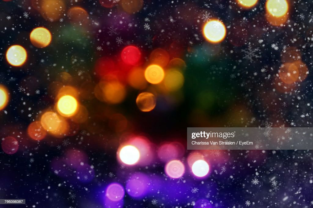 Defocused Image Of Illuminated Lights At Night : Stock Photo