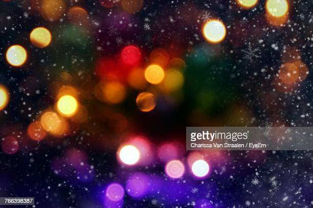 defocused image of illuminated lights at night - holiday stock pictures, royalty-free photos & images