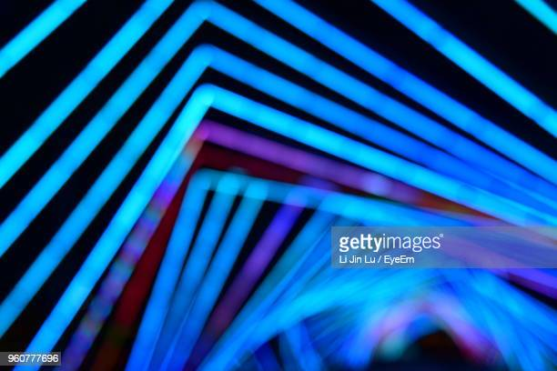 defocused image of illuminated lights at night - neon lighting stock pictures, royalty-free photos & images