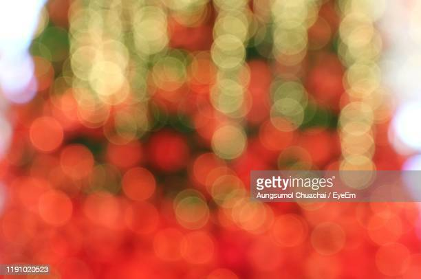 defocused image of illuminated lights - aungsumol stock pictures, royalty-free photos & images