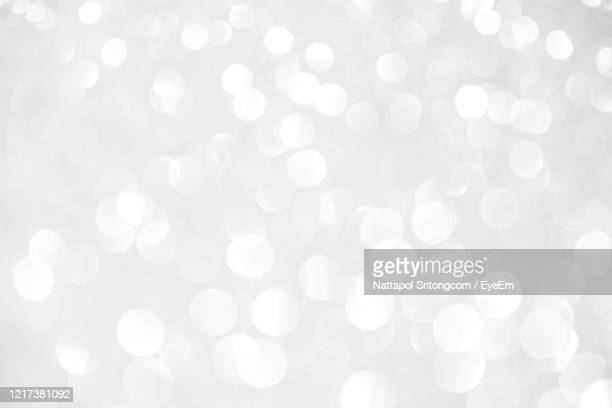 defocused image of illuminated lights - silver coloured stock pictures, royalty-free photos & images