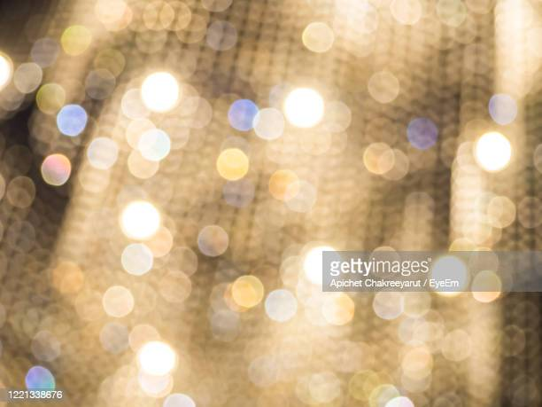 defocused image of illuminated lights - gala stock pictures, royalty-free photos & images