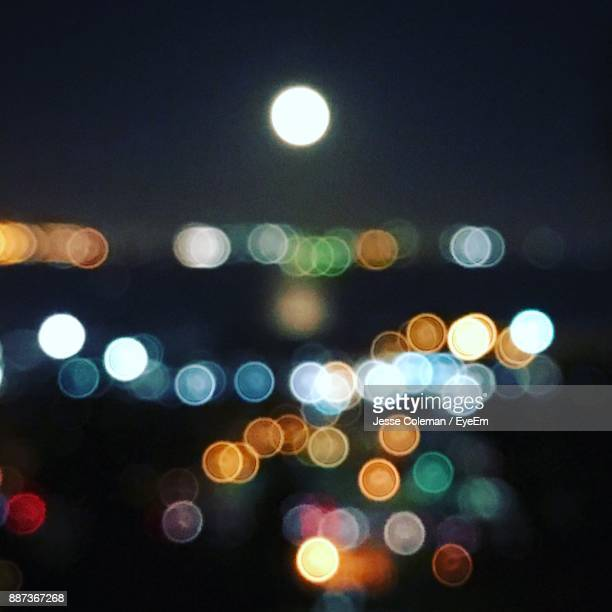 defocused image of illuminated lights - jesse coleman stock photos and pictures
