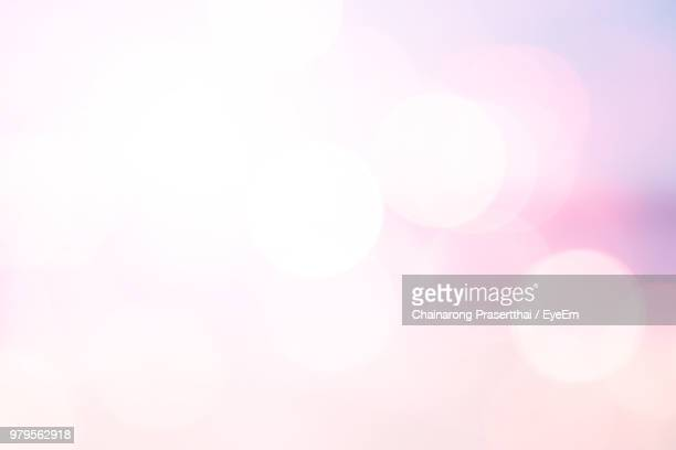 defocused image of illuminated lights - lens flare stock pictures, royalty-free photos & images