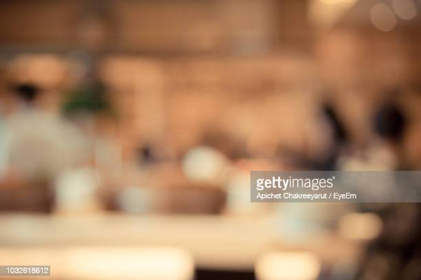 Defocused Image Of Illuminated Restaurant