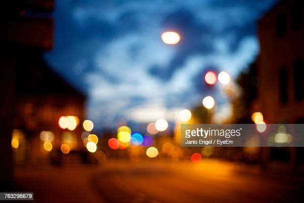 defocused image of illuminated road at night - erlangen stock photos and pictures