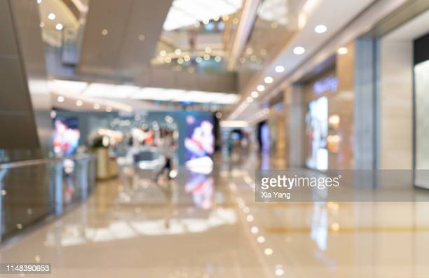 defocused image of interior shopping mall - shopping mall stock pictures, royalty-free photos & images