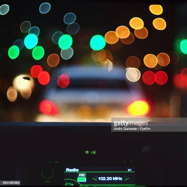 Defocused Image Of Lights At Night Seen Through Car Windshield