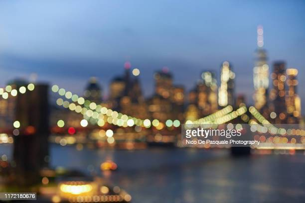 defocused image of new york at night - brooklyn new york stock pictures, royalty-free photos & images