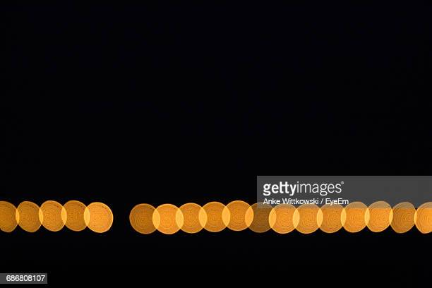 defocused image of orange lights against clear sky at night - undone stock pictures, royalty-free photos & images