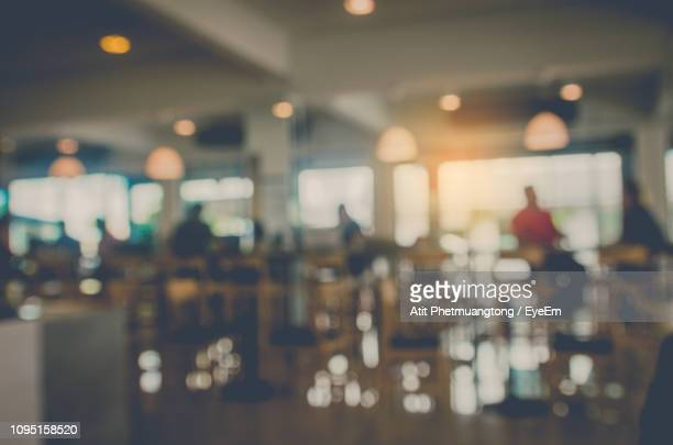 defocused image of people in restaurant - incidental people stock pictures, royalty-free photos & images