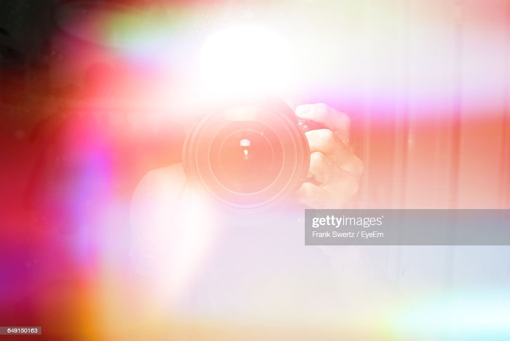 Defocused Image Of Person Photographing Amidst Colorful Lights : Stock Photo
